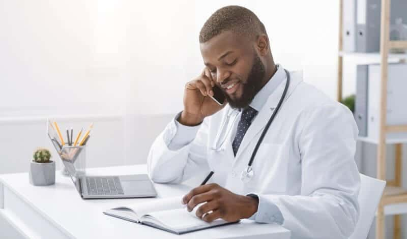 african american doctor giving telemedicine services