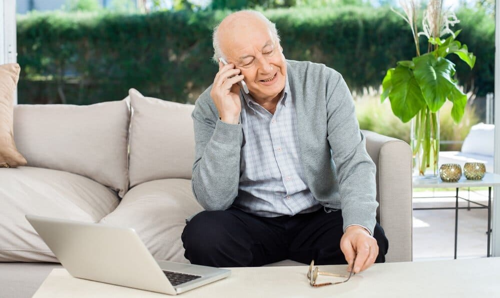 elderly man calling a doctor with a telemedicine plan
