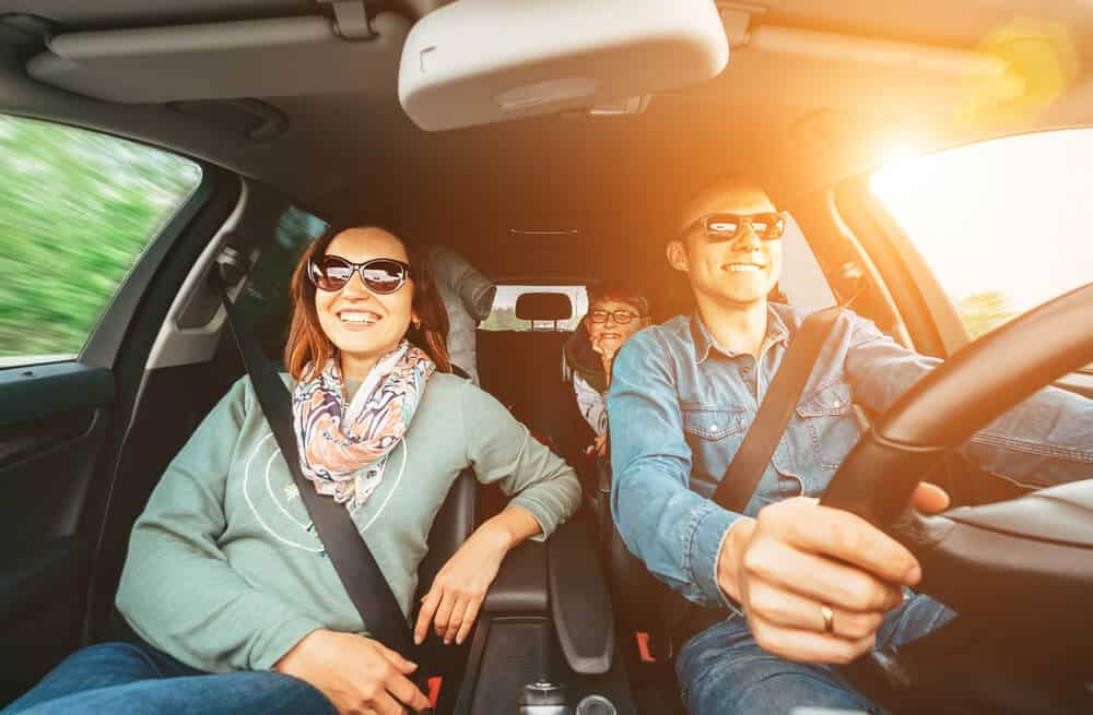 happy family in car with liability insurance